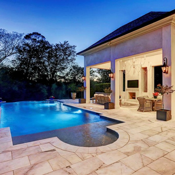 Pool and patio area of luxurious Houston mansion by Thomas O'Neill Homes. #pooldesign #luxuryhomedesign #backyardoasis