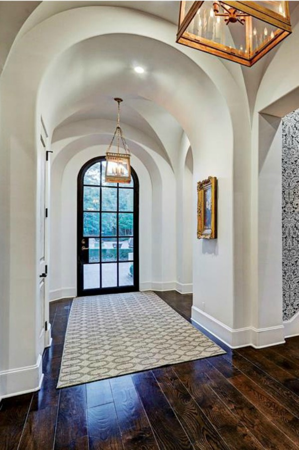 Architectural ceiling arches in an elegant hall of a French country Houston mansion by Thomas O'Neill Homes. #entry #interiordesign #frenchcountry #luxuryhomedesign