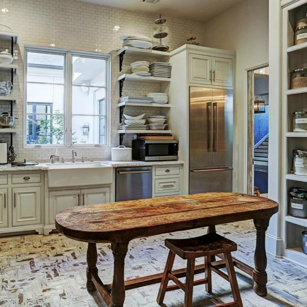 Rustic yet elegant French country butler pantry in a magnificent Houston home by TOH. #butlerpantry #frenchcountry #luxuryhome #homedesign