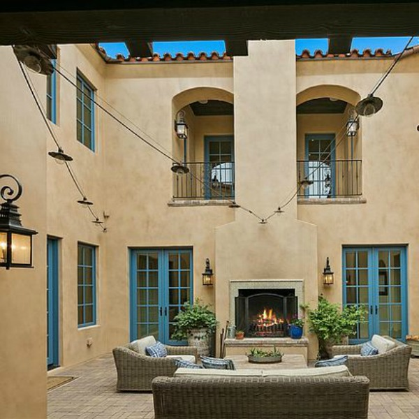 Elegant French Country home exterior in Scottsdale with stucco and arched doors. #houseexterior #frenchcountry #scottsdale