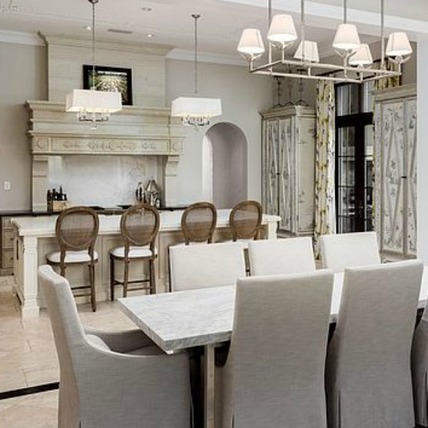Sophisticated white French country kitchen with Louis style counter stools in a magnificent and classic Scottsdale home. #kitchendesign #frenchcountry #luxuriouskitchen #scottsdalehome