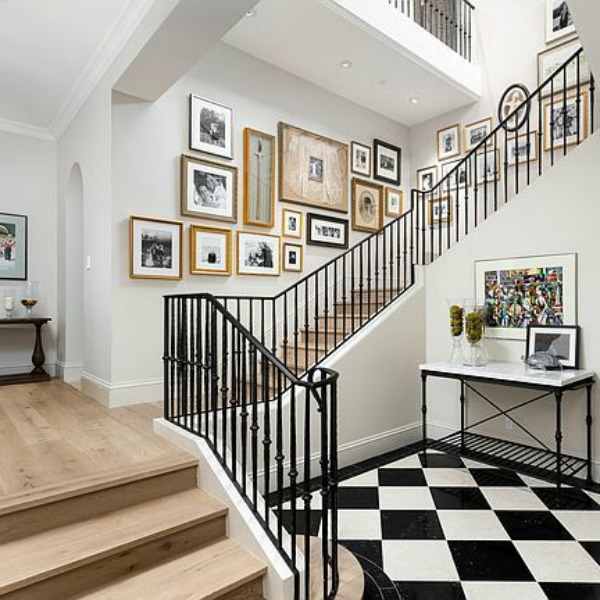 Elegant black and white formal entry and staircase in a classic and luxurious French country inspired Scottsdale home. #entry #elegantdecor #luxurioushome #blackandwhitefloor