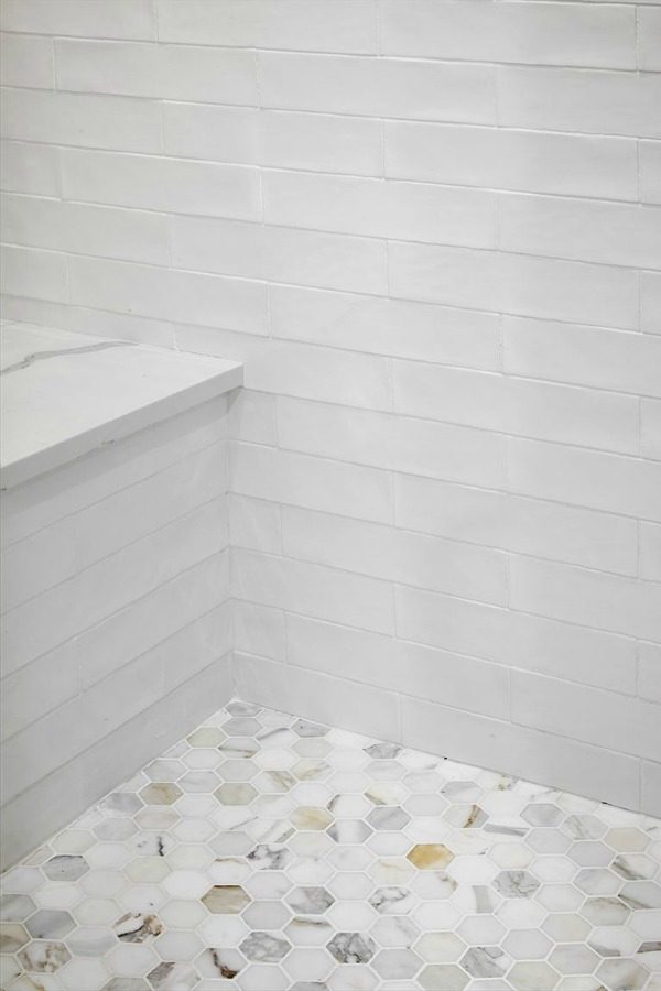 Detail of calacatta gold marble hex tile shower floor in Scrivano house. #fixerupper #scrivanohouse