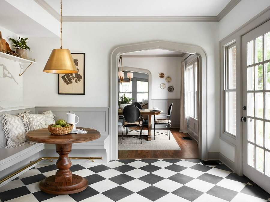 Checkered floors in a vintage style kitchen! This tranquil Tudor cottage was renovated on HGTV's Fixer Upper by Chip and Joanna and is known as the Scrivano House. #fixerupper #scrivano #cottagestyle #interiordesign #greytrim #serenedecor