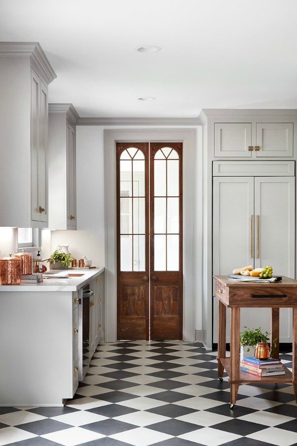 Reclaimed wood doors in kitchen. This tranquil Tudor cottage was renovated on HGTV's Fixer Upper by Chip and Joanna and is known as the Scrivano House. #fixerupper #scrivano #cottagestyle #interiordesign #greytrim #serenedecor