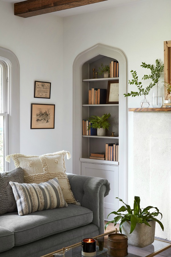 Come get inspired by Tranquil and Timeless Tudor Design Details From a Serene 1920s Texas Cottage renovated on HGTV's Fixer Upper by Chip and Joanna and known as the Scrivano House. #fixerupper #scrivano #cottagestyle #interiordesign #greytrim #serenedecor #livingroom