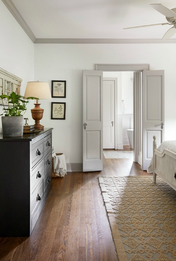 This tranquil Tudor cottage was renovated on HGTV's Fixer Upper by Chip and Joanna and is known as the Scrivano House. #fixerupper #scrivano #cottagestyle #interiordesign #greytrim #serenedecor