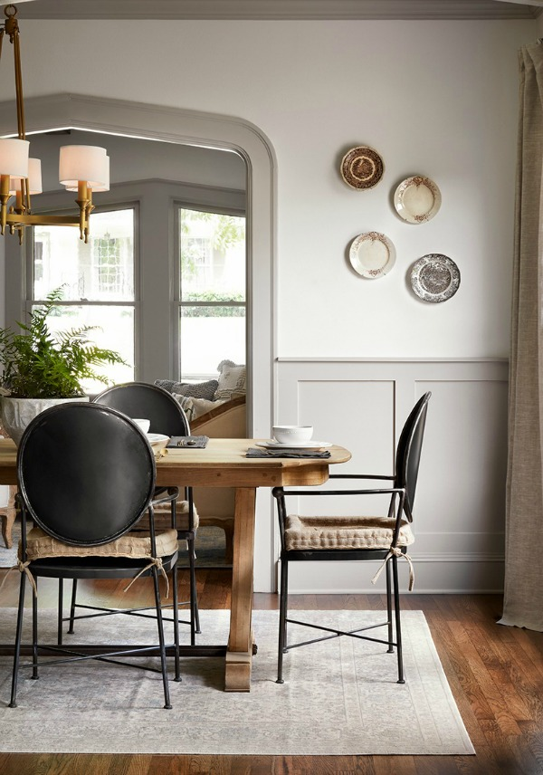 Plates on dining room wall. Come get inspired by Tranquil and Timeless Tudor Design Details From a Serene 1920s Texas Cottage renovated on HGTV's Fixer Upper by Chip and Joanna and known as the Scrivano House. #fixerupper #scrivano #cottagestyle #interiordesign #greytrim #serenedecor