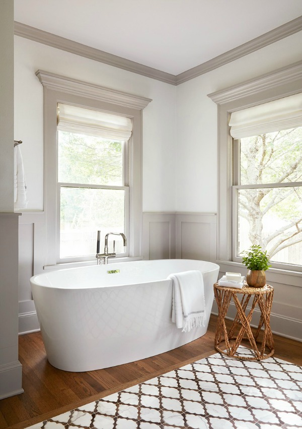 Luxurious tub in vintage style bathroom. This tranquil Tudor cottage was renovated on HGTV's Fixer Upper by Chip and Joanna and is known as the Scrivano House. #fixerupper #scrivano #cottagestyle #interiordesign #greytrim #serenedecor #bathroomdesign
