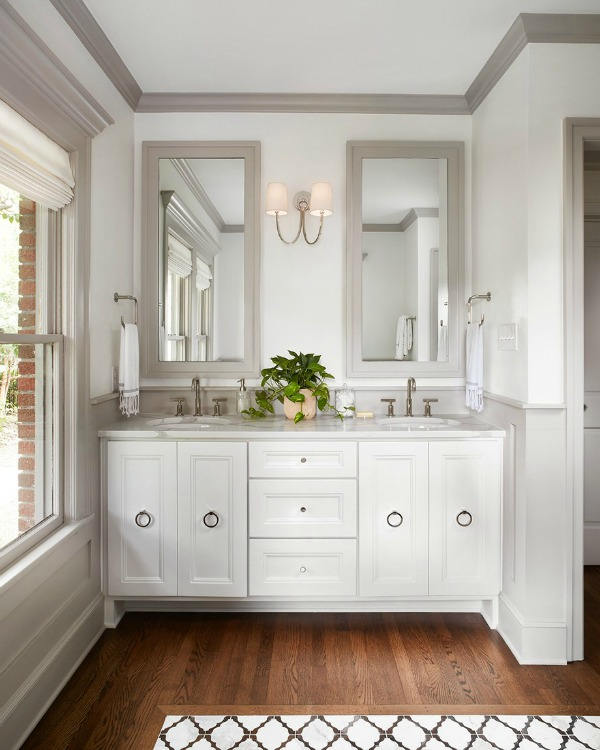 This tranquil Tudor cottage was renovated on HGTV's Fixer Upper by Chip and Joanna and is known as the Scrivano House. #fixerupper #scrivano #cottagestyle #interiordesign #greytrim #serenedecor #bathroomvanity