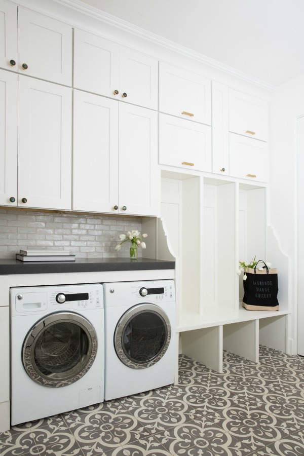 Modern farmhouse laundry room with built-ins, decorative Moroccan style tile floor, and subway tile backsplash - Jaimee Rose Interiors.