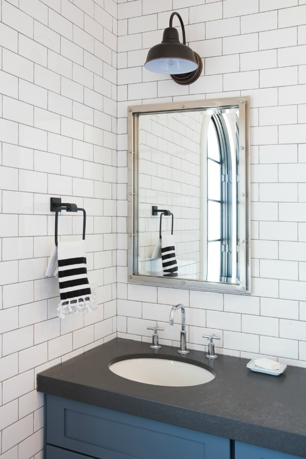 Modern farmhouse bathroom with subway tile and black vanity top - Jaimee Rose Interiors.
