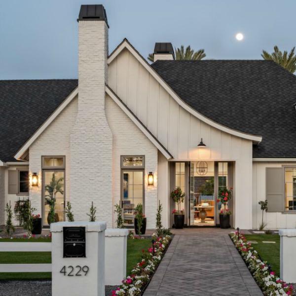 Classic white modern farmhouse exterior. #interiordesign #modernfarmhouse #houseexterior