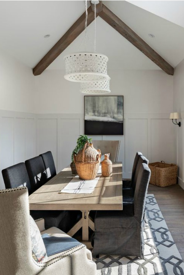 Dining room with vaulted ceiling and wood beams - interior design by Jaimee Rose Interiors.