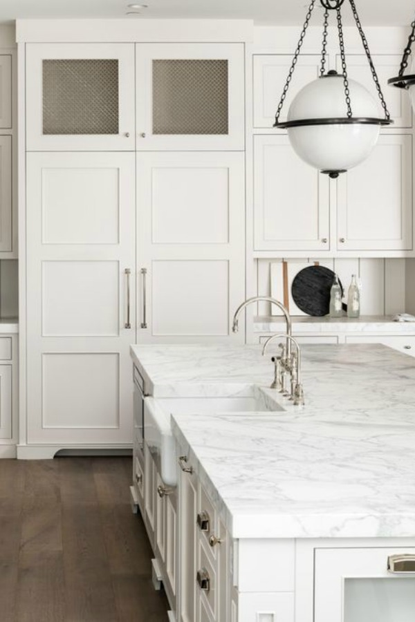Classic white custom kitchen cabinets, midcentury modern globe pendants, and polished nickel hardware - Jaimee Rose Interiors.