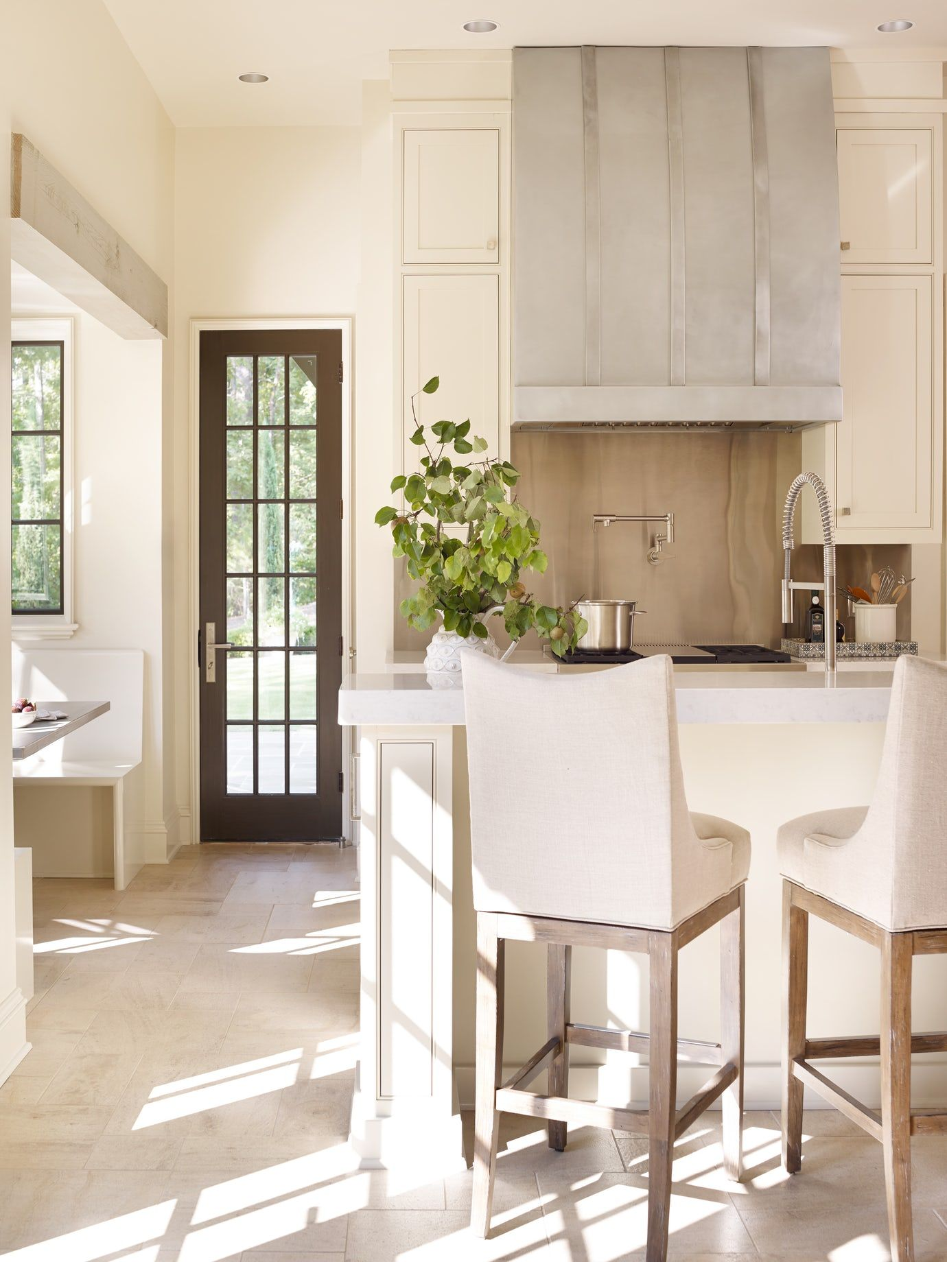 A gorgeous bespoke kitchen with pale tones and lovely texture - Jeffrey Dungan.