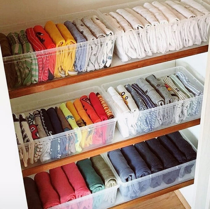 Perfectly organized tshirts in clear containers on shelves in an organized closet - @cos_mycloset. #closetgoals #organizedcloset #organizationideas