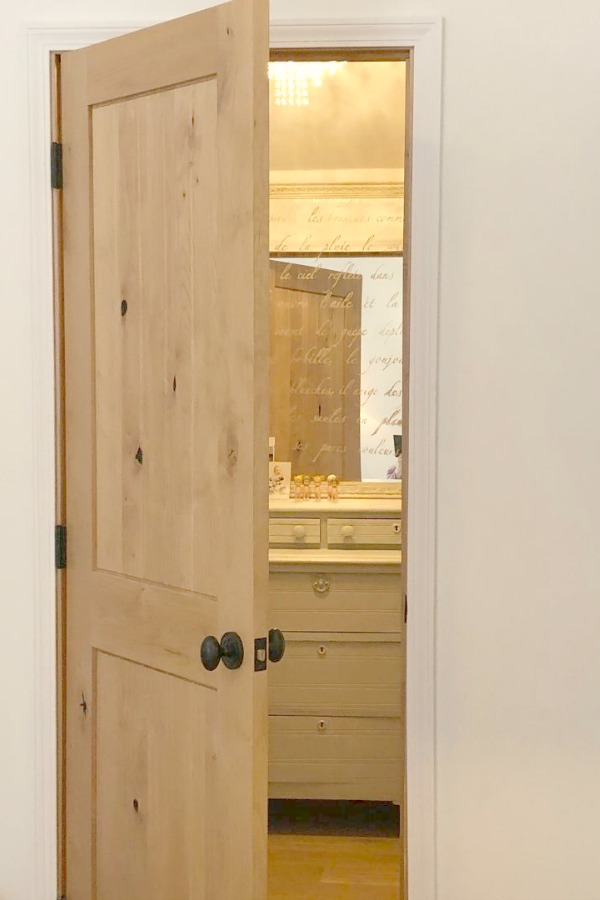 Knotty alder wood interior door to my closet - Hello Lovely Studio. #closet #alderdoor #hellolovelystudio #interiordesign