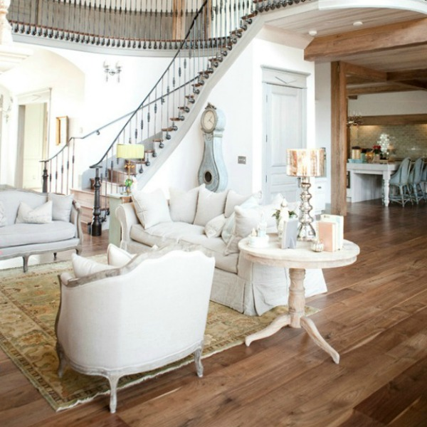 Walnut floors in living room with magnificent French staircase - come tour French Fantasy House Build: A Timeless Tranquil Home Favorite!