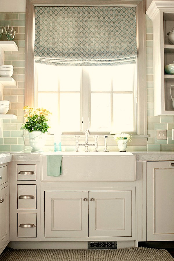 Serene seaglass green subway tiles in white French country kitchen with farm sink - come tour French Fantasy House Build: A Timeless Tranquil Home Favorite!