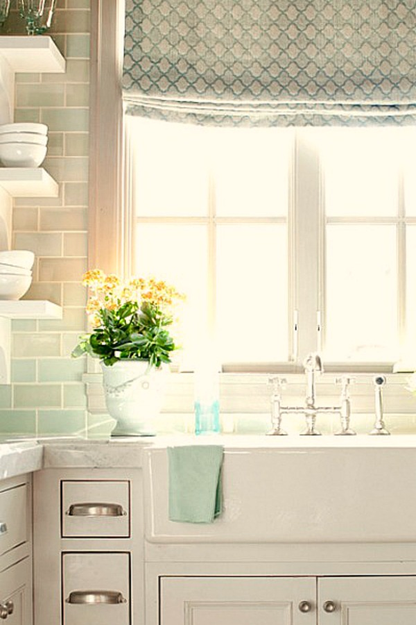 Serene white and bright French kitchen with farm sink and light green subway tile backsplash - come tour French Fantasy House Build: A Timeless Tranquil Home Favorite!