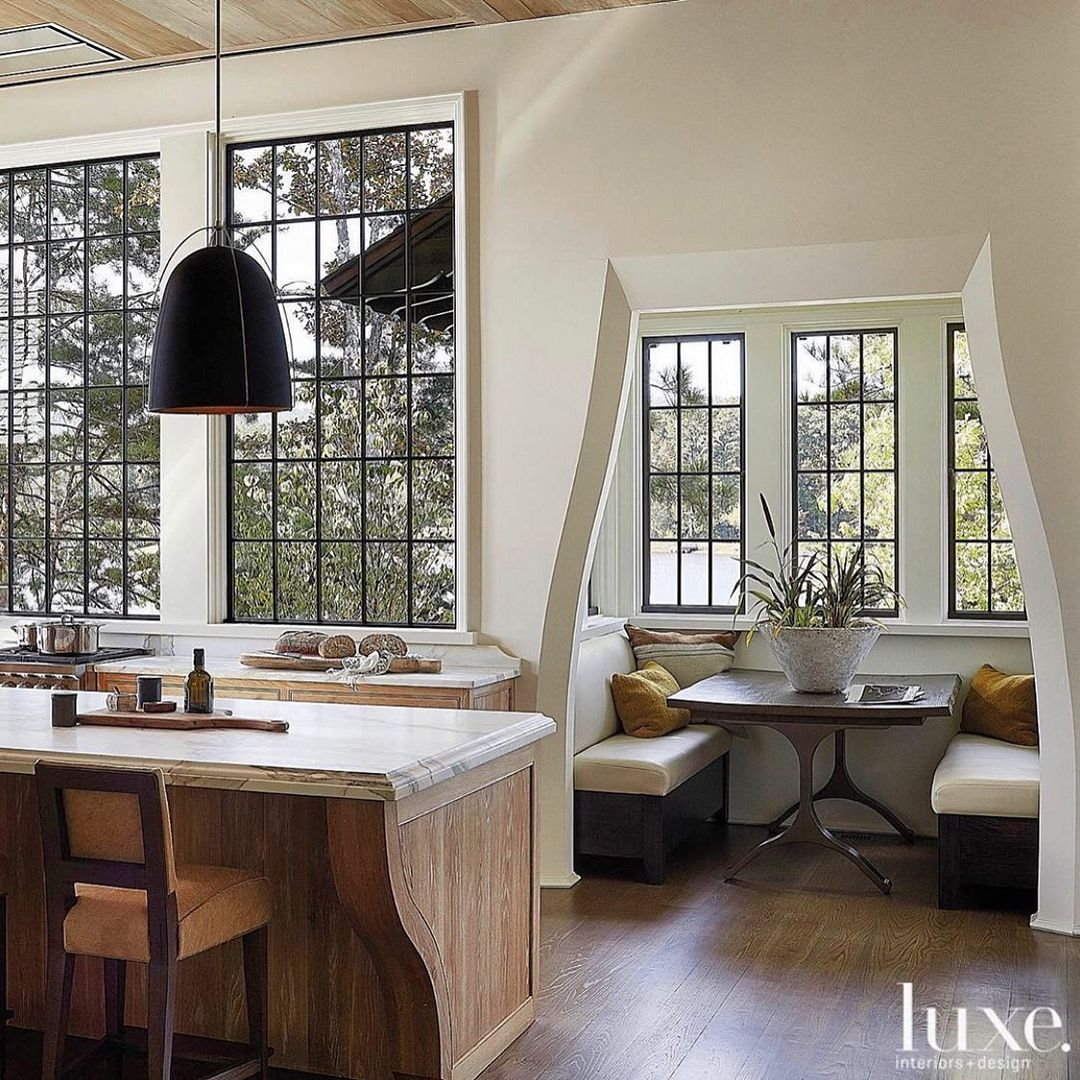 Jeffrey Dungan designed kitchen with amazing architecture and built-in breakfast nook - Luxe Magazine.