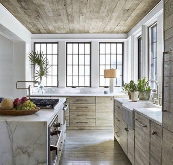 Serene kitchen with timeless architecture and design by Atlanta-based Jeffrey Dungan who mixes rustic with elegant in luxury home design. #architecture #luxuryhome #jeffreydungan #timelessdesign #kitchen