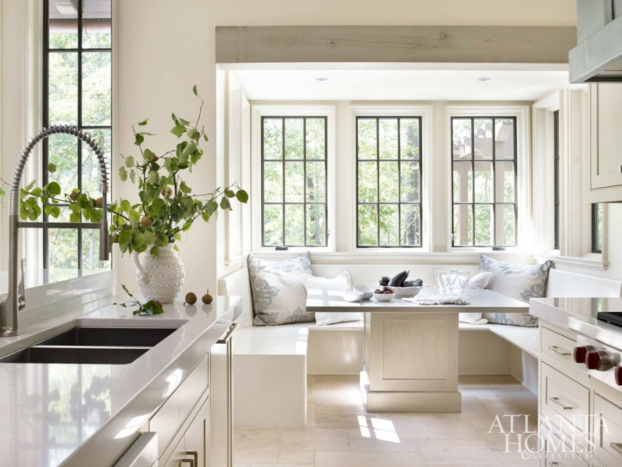 Timeless kitchen architecture and design (look at that built in booth!) by Atlanta-based Jeffrey Dungan who mixes rustic with elegant in luxury home design. #architecture #luxuryhome #jeffreydungan #timelessdesign #sophisticateddesign