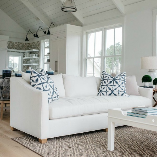 White coastal cottage living room with interior design by Lisa Furey. #coastalcottage #interiordesign #livingroom