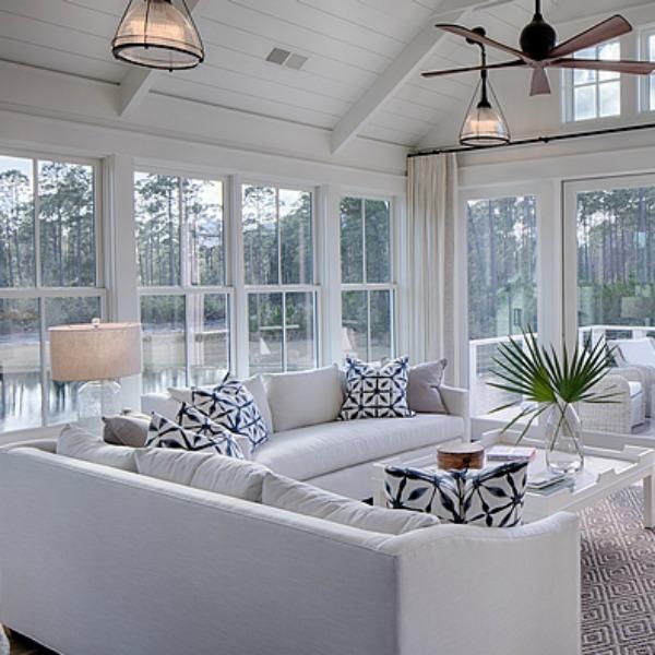 Beautiful white coastal cottage great room with indigo blue accents. #livingroom #interiordesign #cottagestyle #coastalcottage