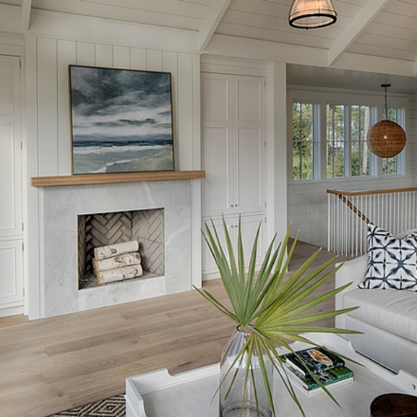 Coastal cottage fireplace in great room of a Palmetto Bluffs lake house by Lisa Furey. #fireplace #coastalcottage #interiordesign