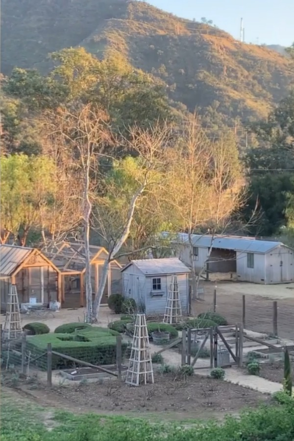 Beautiful view of outbuildings at Patina Farm in Ojai, California, where the Giannettis have created a little Eden for a few lucky animals to shelter. #patinafarm #giannettihome #farmhousedesign #outbuildings
