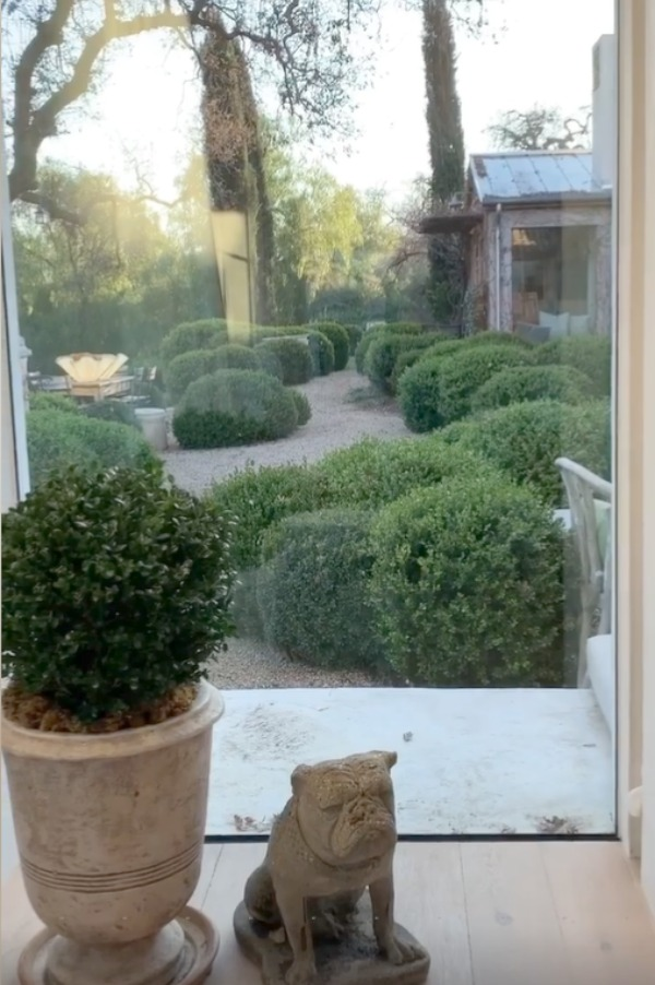 Beautiful French farmhouse style gardens at Patina Farm in Ojai, California with pea gravel and boxwood. #patinafarm #frenchfarmhouse #frenchcourtyard #gardendesign #europeancountry