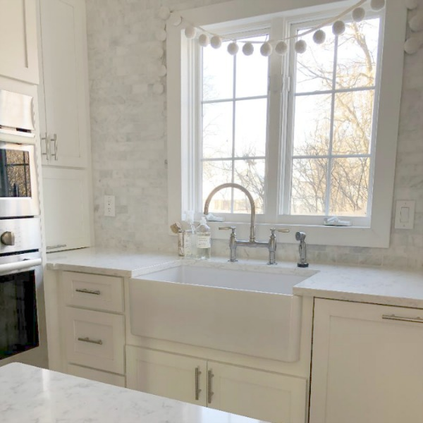 Minuet Viatera quartz countertop in our classic white kitchen with Shaker cabinets and stainless appliances. #hellolovelystudio #whitequartz #countertops #kitchendesign #minuet #viateraquartz #lgviatera
