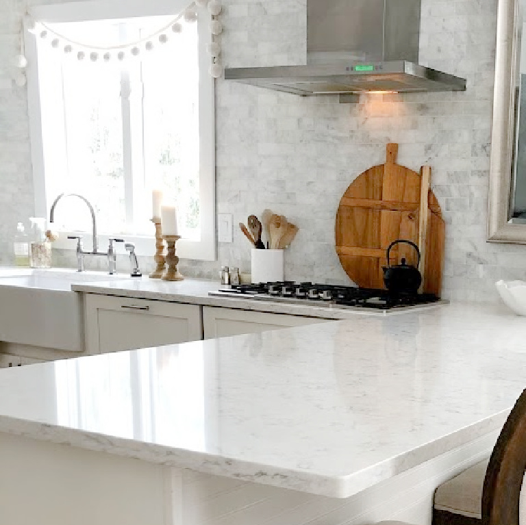 Viatera Minuet quartz countertop in my classic white kitchen (with Modern French influence) paired with polished marble subway tile backsplash - Hello Lovely Studio. #whitequartz #quartzcountertops #minuet