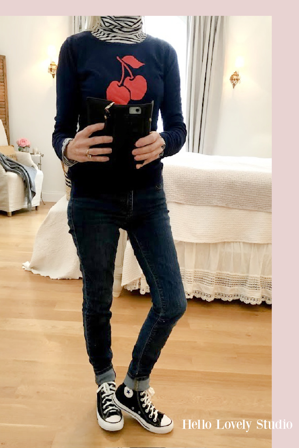 Hello Lovely Studio casual winter fashion over 50 - navy cherry sweater, jeans and Converse high tops. #fashionover50 #casual #navy