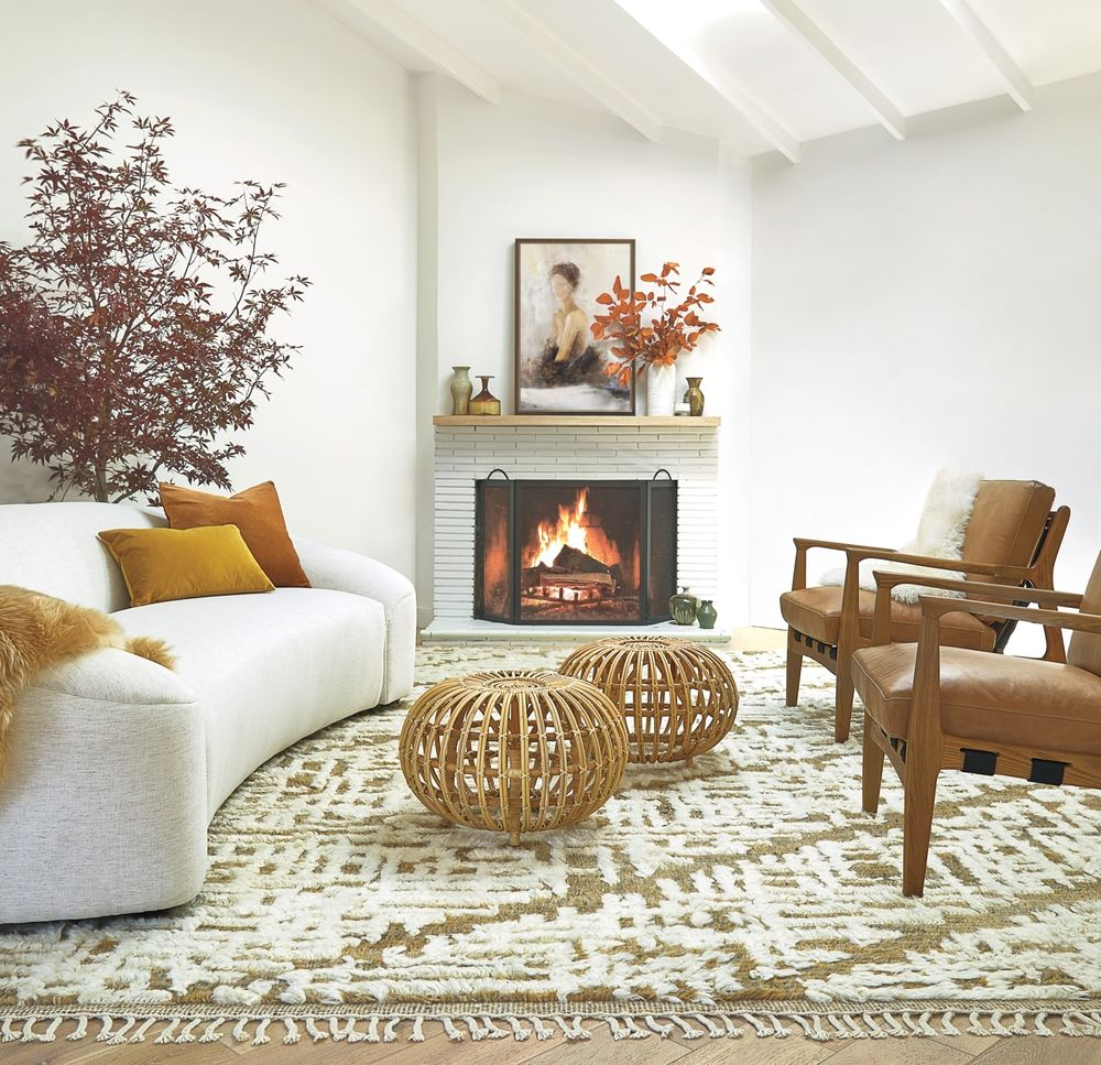 Cozy white living room with rustic accents and an airy coastal organic Cali vibe - Lulu & Georgia. #whitedecor #livingroom #casualstyle #interiordesign #neutraldecor