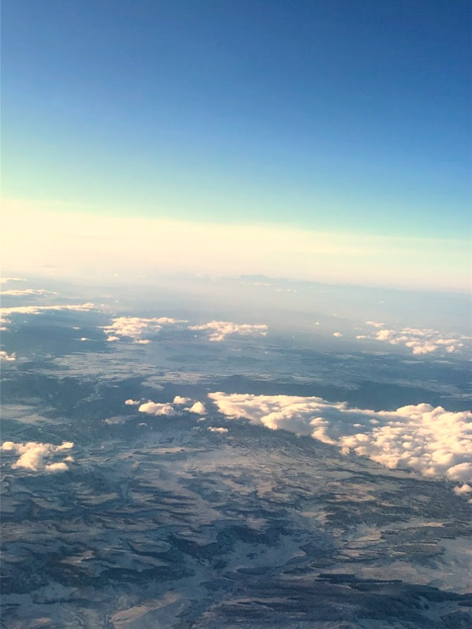 Clouds, blue sky, and ice from airplane - Hello Lovely Studio.