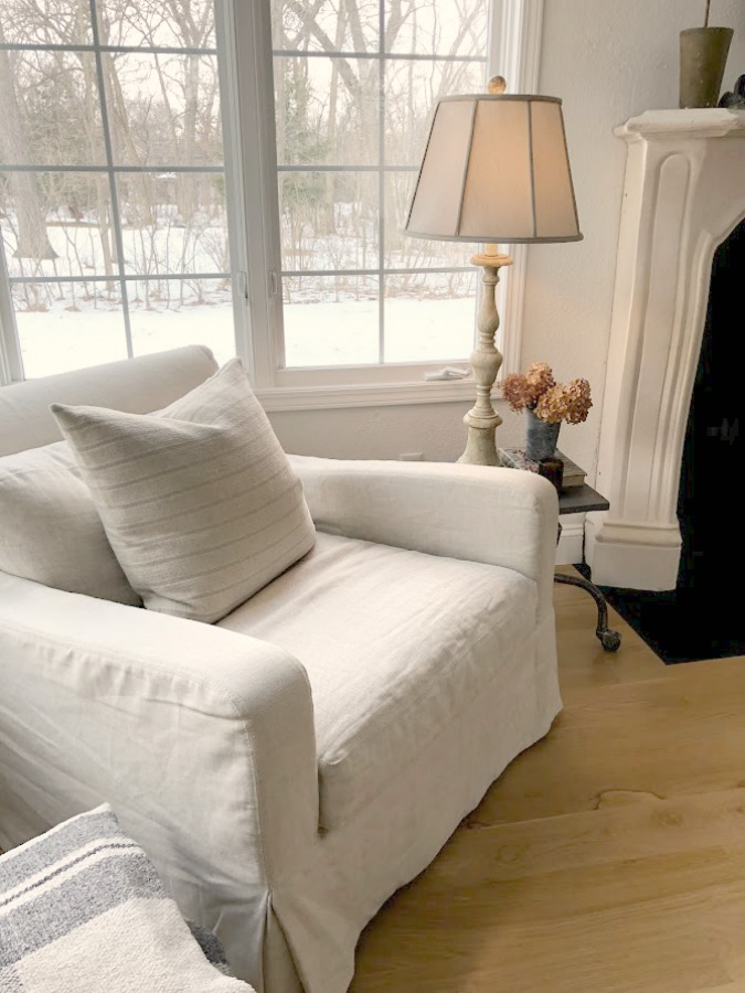Belgian linen upholstered club chair (RH) in our living room with white oak hardwood flooring - Hello Lovely Studio. #belgianlinen #livingroom #interiordesign #neutraldecor