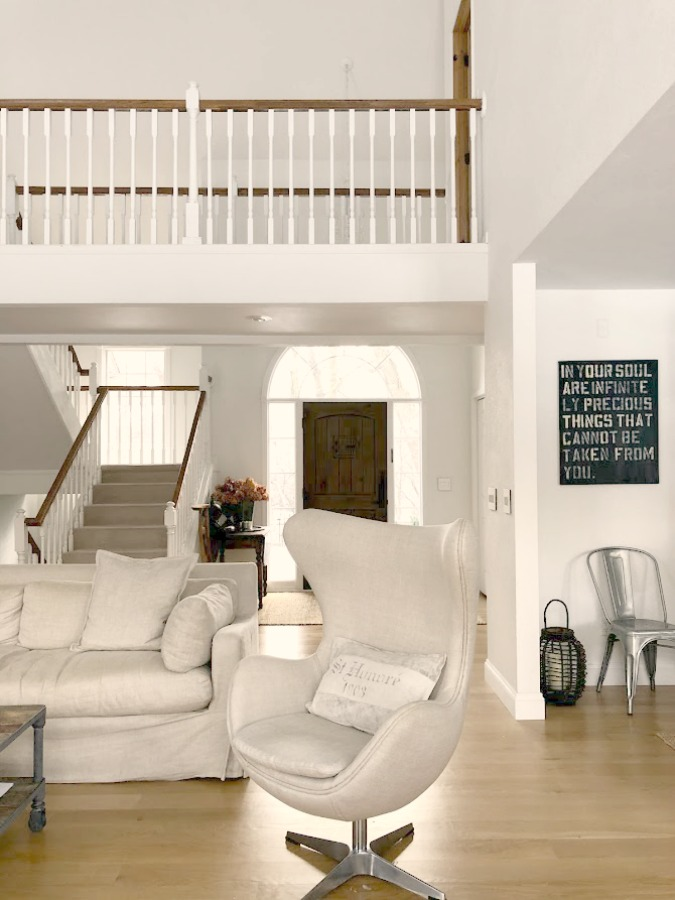 Living room with Copenhagen egg chair (RH), staircase and catwalk - Hello Lovely Studio. #livingroom #belgianstyle