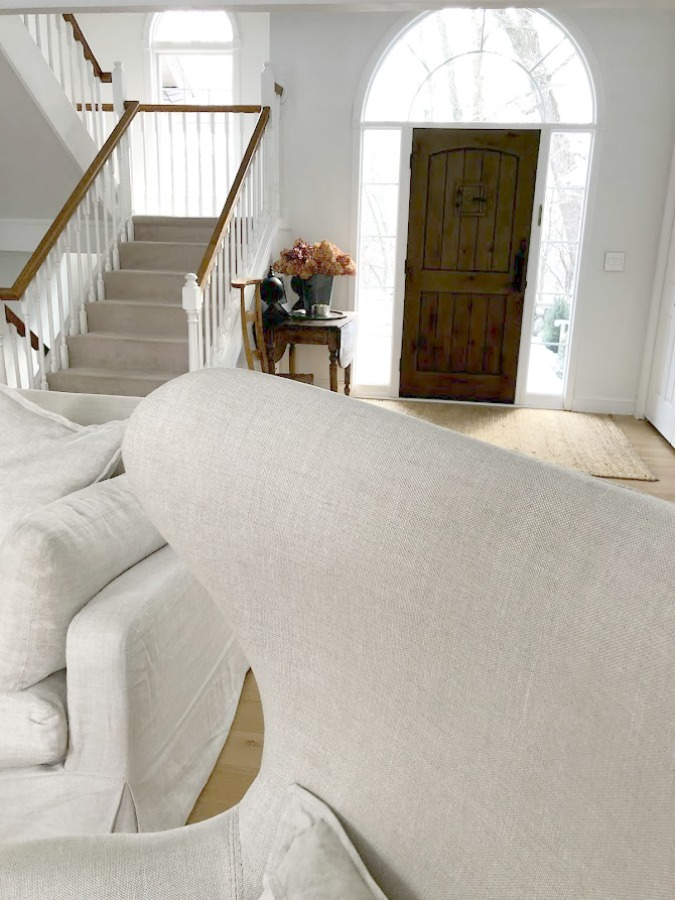 White oak hardwood flooring and Belgian linen upholstered Copenhagen egg chair (RH) in our living room - Hello Lovely Studio. #eggchair #belgianlinen #belgianstyle #livingroom #whiteoak #hardwoodfloor