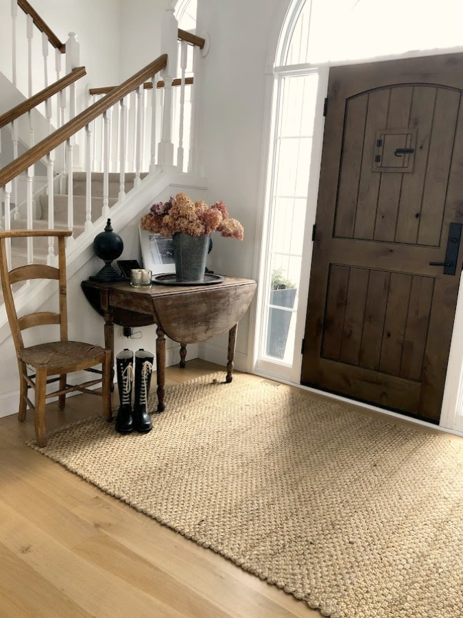 Neutral decor and vintage style in our European country style entry with white oak hardwood flooring - Hello Lovely Studio. #europeancountry #entry #whiteoak #hardwoodflooring