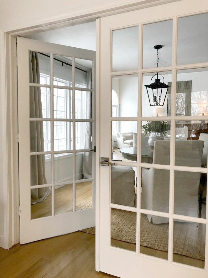 French doors from kitchen to dining room in our European country inspired home - Hello Lovely Studio.