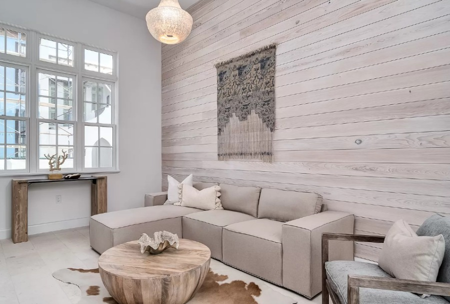 Luxurious neutral and serene den with grey wood statement wall in a coastal home by Domin Bock. #alysbeach #coastalhome #luxurioushome #warmminimal #den #interiordesign