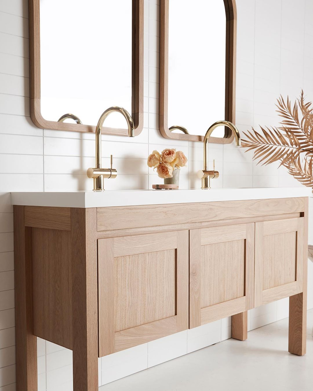 Custom oak freestanding vanity by Loughlin Furniture. #customvanity #bespokebathroom #oakvanity #bathroomdesign