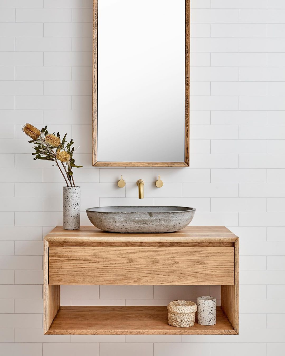 Bespoke wood vanity with vessel sink and white wall of subway tile - Loughlin Furniture. #bespokebathroom #bathroomdesign #customvanity #vesselsink