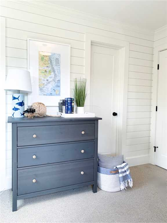 Charming blue and white classic coastal bedroom with shiplap - Summerfell Cottage. #coastalstyle #shiplapwall #blueandwhite #interiordesign #bedroomdecor