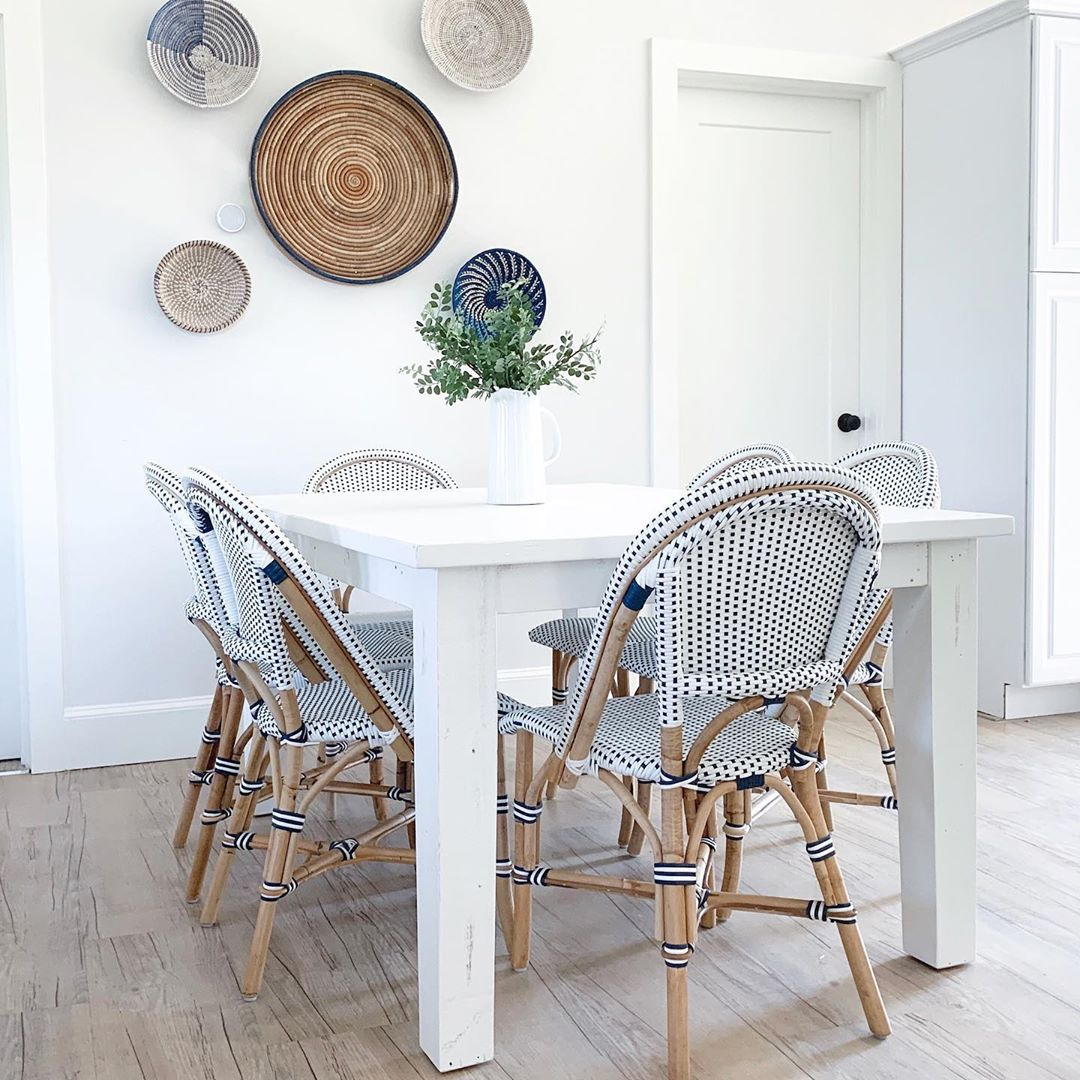 Coastal, minimal, serene blue and white dining room with Parisian bistro chairs in Summerfell Cottage in NC. #diningroom #coastalstyle #blueandwhite #interiordesign #bistrochairs