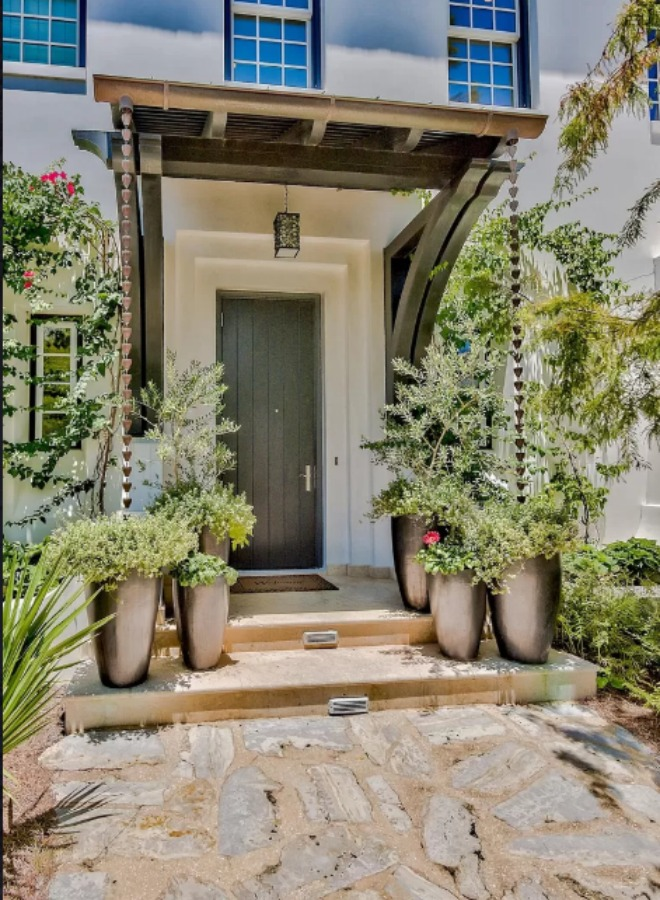 Lush and sophisticated front entry to a magnificent coastal home (Alys Beach) by Domin Bock. #houseexterior #housedesign #coastalhome #alysbeach