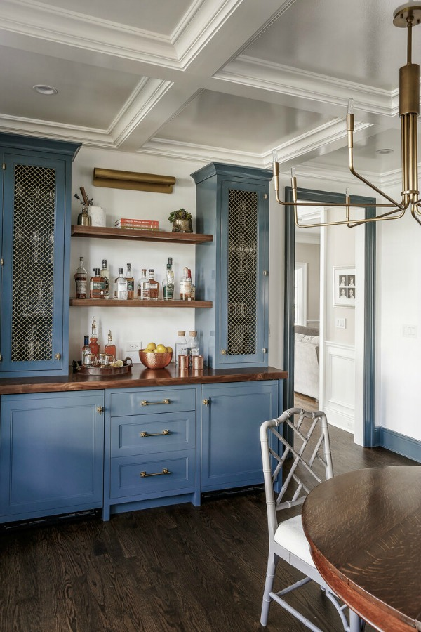 Blue cabinets and open shelves in bar area of magnificent remodeled home by Edward Deegan Architects. #bluecabinets #kitchendesign #openshelving